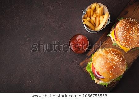 Lezzetli ızgara Burger pişirme sığır eti Stok fotoğraf © karandaev