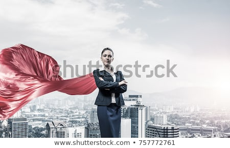 Power and determination of a young business woman against a wrecking ball Stock photo © alphaspirit