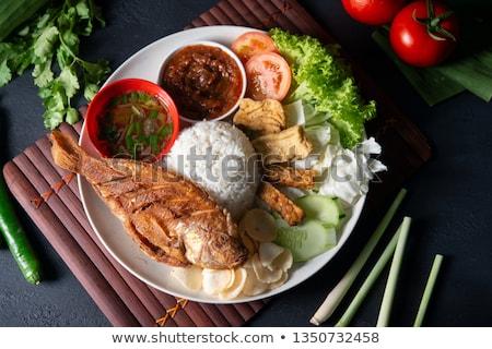 Fried tilapia fish and rice Stock photo © szefei