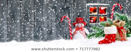 new year decoration spruce branch santa stockings stock photo © robuart