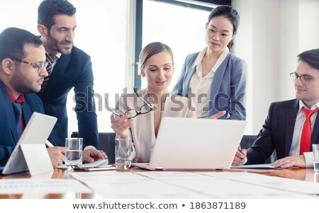 Business advisors structuring a deal Stock photo © Kzenon