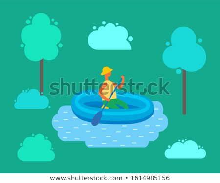 Man in Hat Swimming on Inflatable Rubber Boat Stock photo © robuart