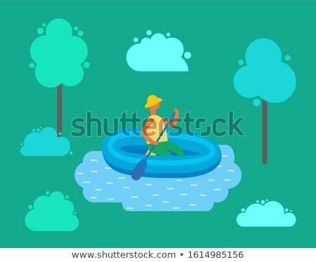 Człowiek hat pływanie nadmuchiwane gumy łodzi Zdjęcia stock © robuart