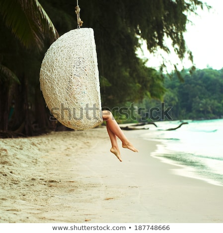 Woman's Feet On Hammock Hanging On Palm Tree Stock photo © AndreyPopov