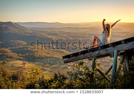 Freedom loving woman feeling exhilaration on ramp high above the valley Stock photo © lovleah