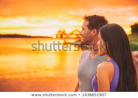 gelukkig · jonge · romantische · paar · ontspannen · strand - stockfoto © maridav