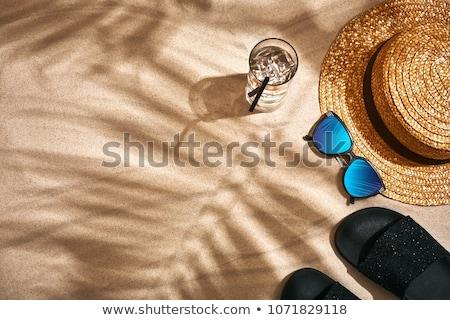 Strohoed strandzand zomer vakantie vakantie strand Stockfoto © dolgachov