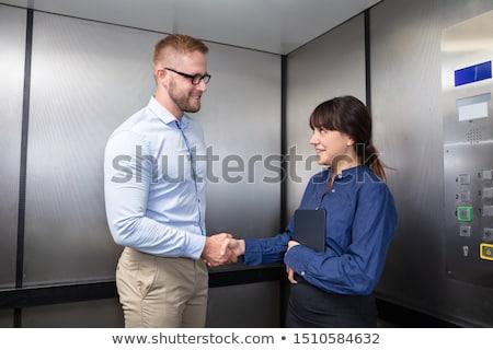twee · glimlachend · zakenvrouw · handen · schudden · kantoor · business - stockfoto © andreypopov