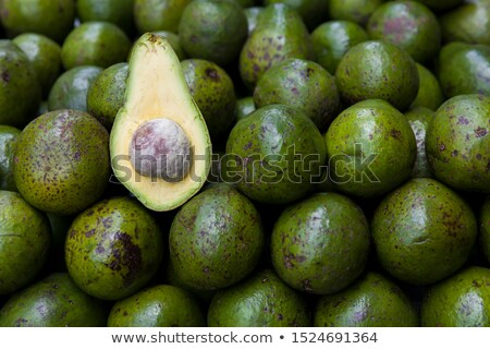 Avocado heap on stall at open market Stock photo © boggy