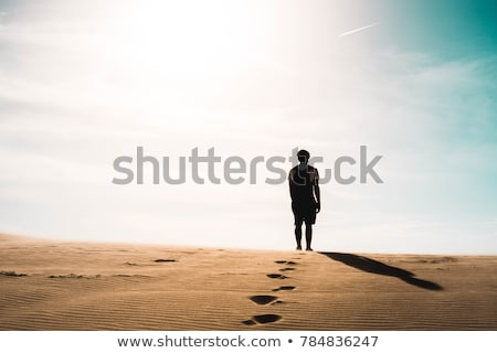 A man lost in the red desert in Vietnam, Mui Ne Stock photo © galitskaya