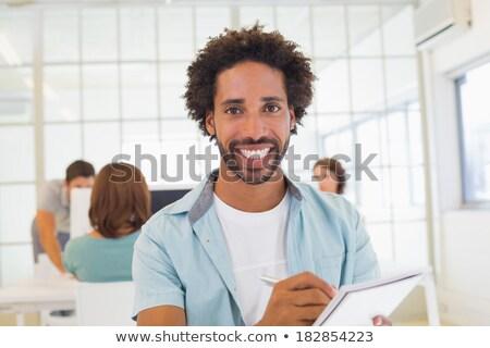 Frente vista jóvenes mujer de negocios escrito Foto stock © wavebreak_media
