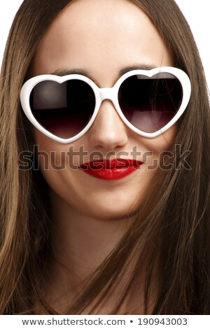 smiling red haired girl in heart shaped sunglasses Stock photo © dolgachov