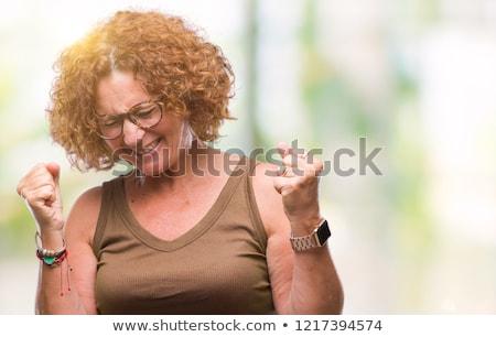 Portret gelukkig senior vrouw vieren triomf Stockfoto © dolgachov