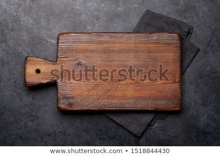 Cutting board over towel on stone kitchen table Stock photo © karandaev