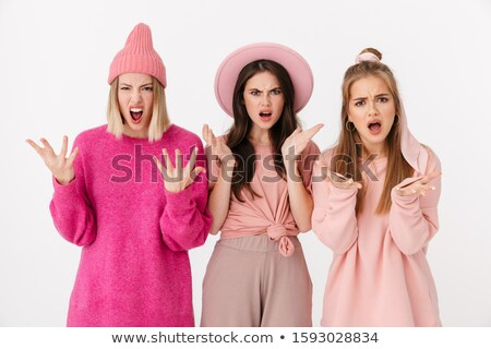 Image of three confused girls wearing pink clothes expressing ou Stock photo © deandrobot