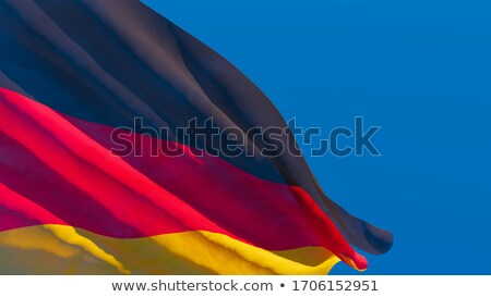 3D rendering of the German national flag against a blue sky Stock photo © butenkow