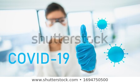 COVID-19 text sign lab researcher happy thumbs up in success of finding a cure vaccine for coronavir Stock photo © Maridav