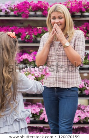 mother and daughter hold pots with flowers in shop stock photo © Paha_L
