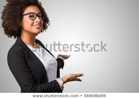 Zakenvrouw tonen presenteren iets permanente witte Stockfoto © Maridav