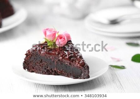 Part of chocolate cake with flowers of rose Stock photo © boroda
