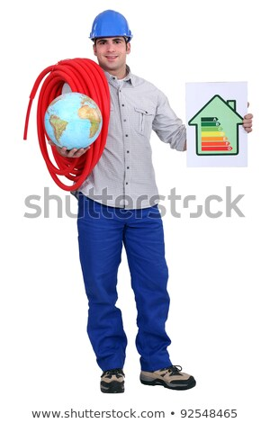 Artisan with globe and energy rating panel Stock photo © photography33
