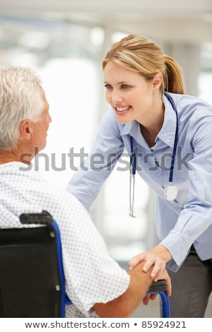 doctor talking to a woman in a wheelchair stock photo © photography33