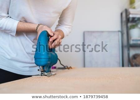 Tradeswoman holding up a jigsaw Stock photo © photography33