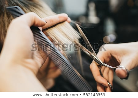 Cabelo estilista trabalhar tesoura mão Foto stock © erierika