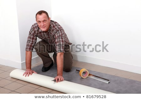 Man kneeling to cut tile to size Stock photo © photography33