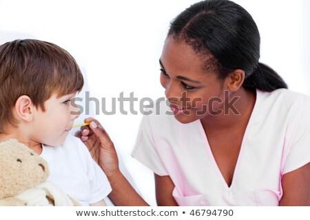 женщины медсестры температура больницу женщину Сток-фото © wavebreak_media