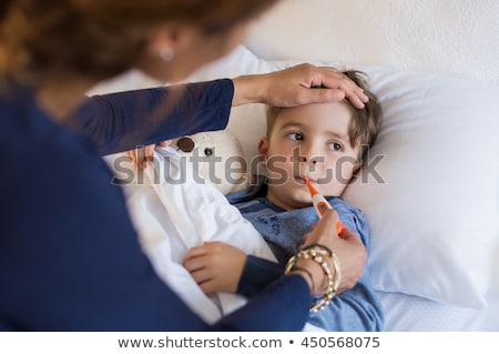 mother taking care of her sick child at home stock photo © wavebreak_media