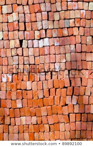 red stapled bricks give a harmonic pattern in the sun stock photo © meinzahn