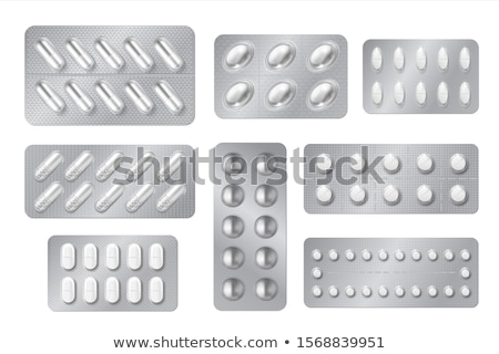 Capsules packed in blisters Stock photo © Lekchangply