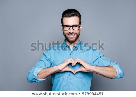 attractive young man making hand gesture stock photo © feedough