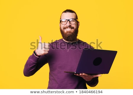 Man showing pictures stored in camera Stock photo © stockyimages