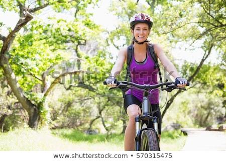 Bisiklete binme kadın genç sokak alışveriş yaz Stok fotoğraf © val_th