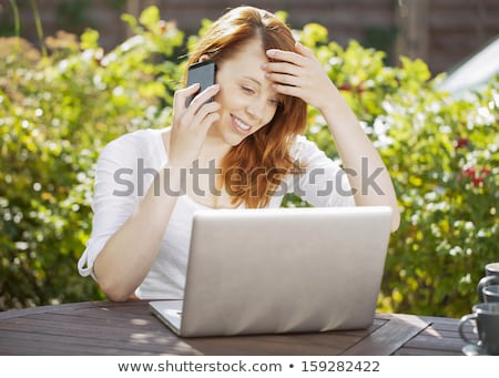 young girl sitting in front of her notebook stock photo © cursedsenses