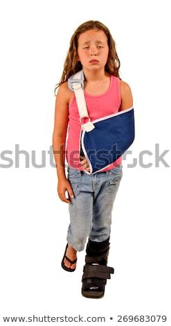 sad girl with a broken arm and leg Stock photo © JackyBrown