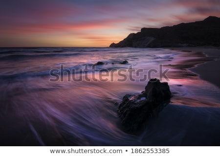 Orange sunrise color on the long beach line Stock photo © shihina