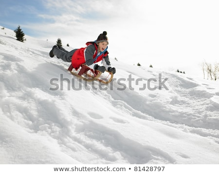 Pre-teen Boy On A Sled In The Snow Stock photo © monkey_business
