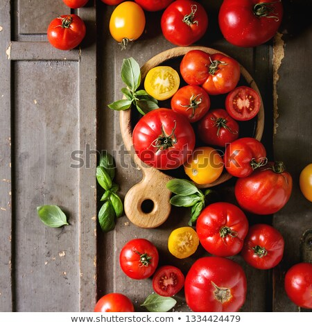 red and yellow tomatoes on board stock photo © m-studio