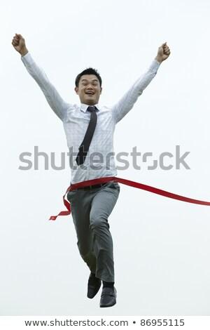Asian business man on position ready to run. Stock photo © szefei