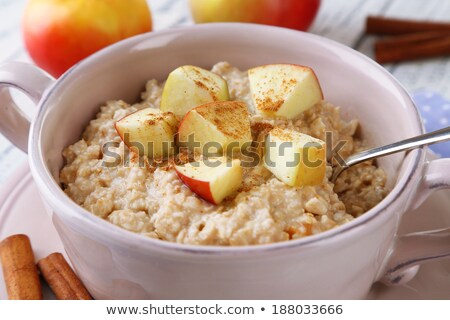 tasty oatmeal with apples and cinnamon stock photo © vankad