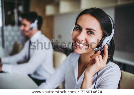 Sorridente feminino operador fone negócio Foto stock © deandrobot
