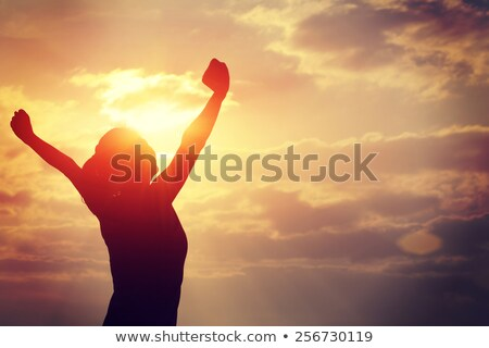 Woman With Arms Raised Standing In Ocean Stock photo © AndreyPopov