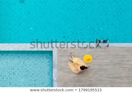 Kadın oturma kenar yüzme havuzu su Stok fotoğraf © AndreyPopov