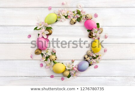 composite image of speckled colourful easter eggs in a green wic stock photo © wavebreak_media