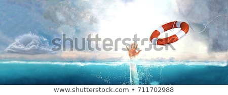 Life buoy for drowning rescue on water Stock photo © LoopAll