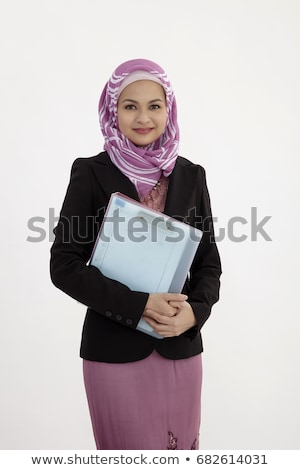 Smiling Pretty Businesswoman Holding a File Folder Stock photo © juniart