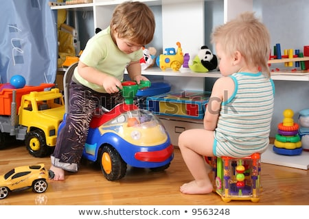 two children in playroom  with toy scooter Stock photo © Paha_L